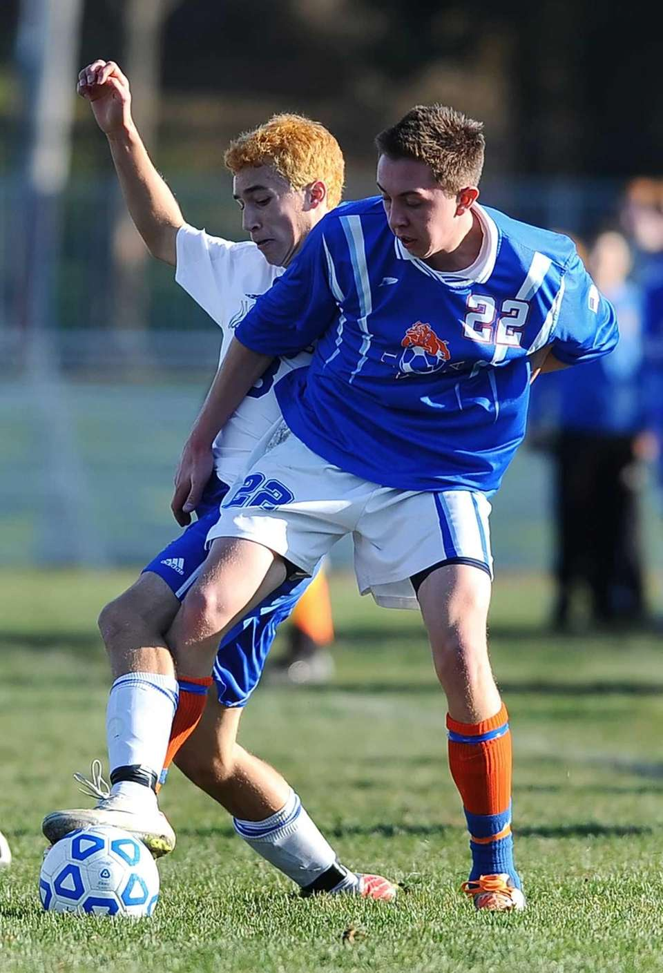Mattituck's Walter Jacob, left, reaches around Livonia's Cody