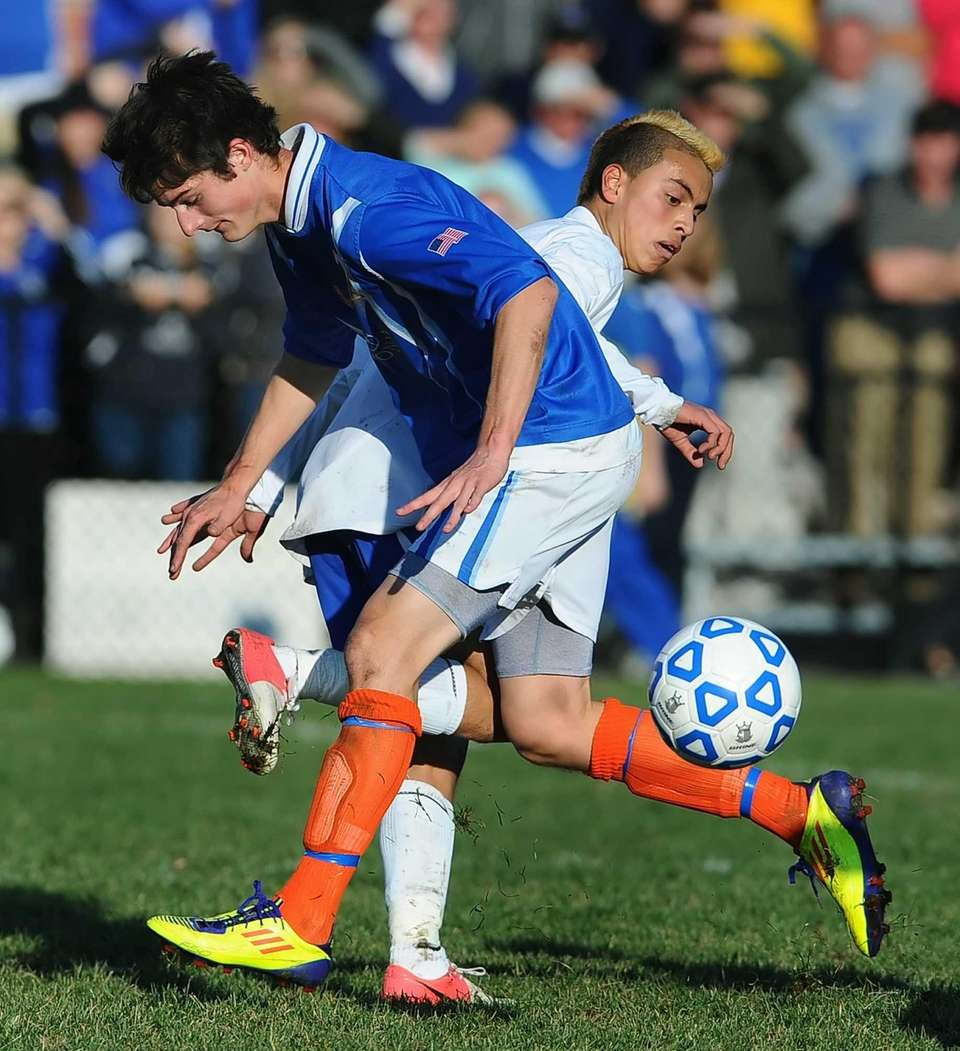 Mattituck's Mario Arreola, right, knocks the ball away