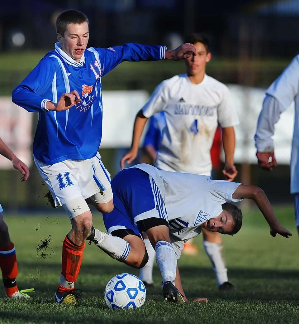 Mattituck's Paul Hayes, right, is tripped up by