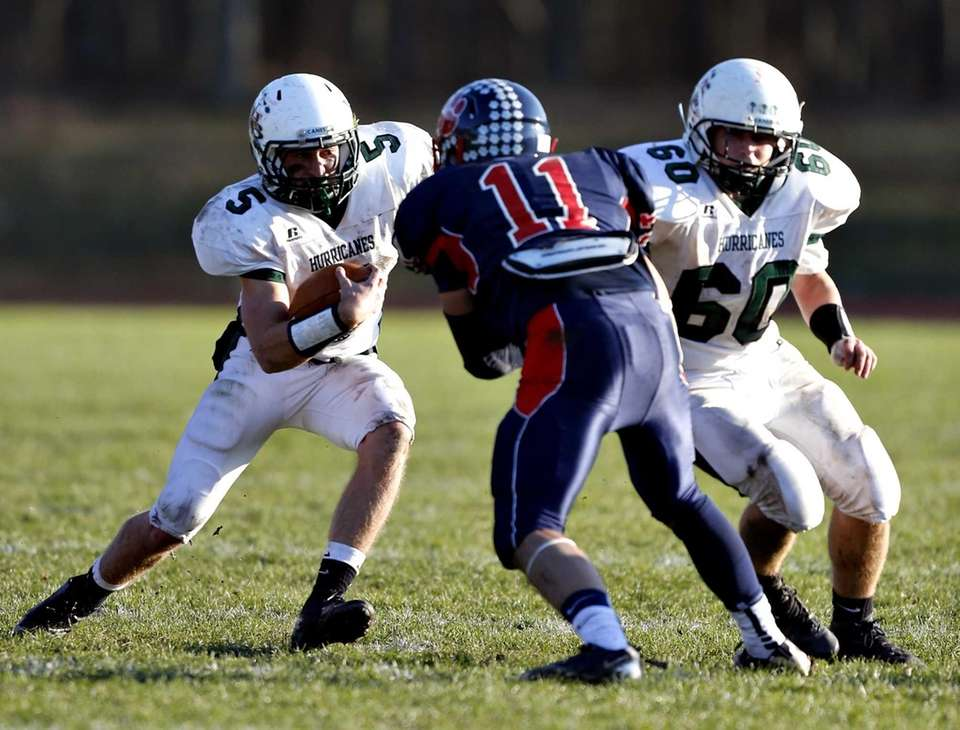 Westhampton quarterback Jack Murphy tries to cut behind