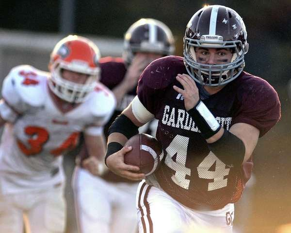 Garden City's Tim McDonagh fights for yards in