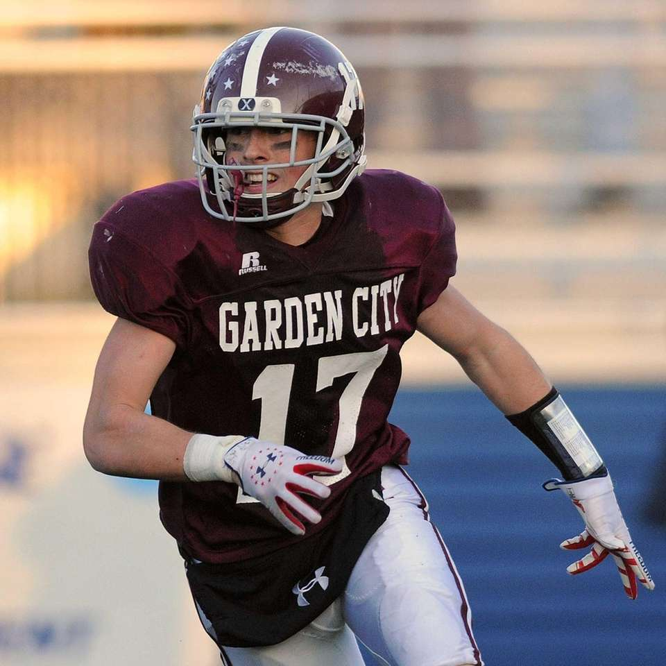 Garden City Justin Guterding reacts after his team