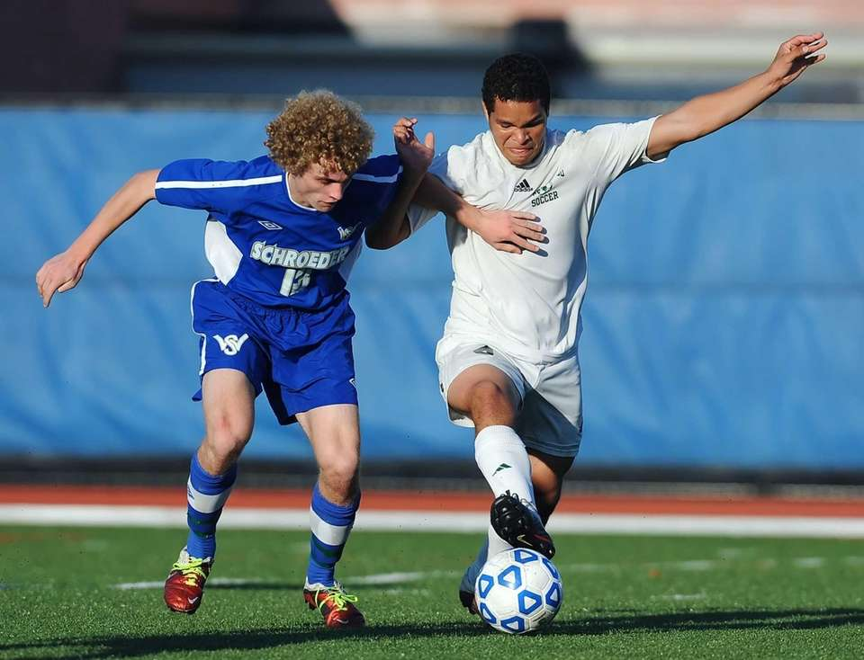 Brentwood's Daniel Aguilar, right, touches the ball away