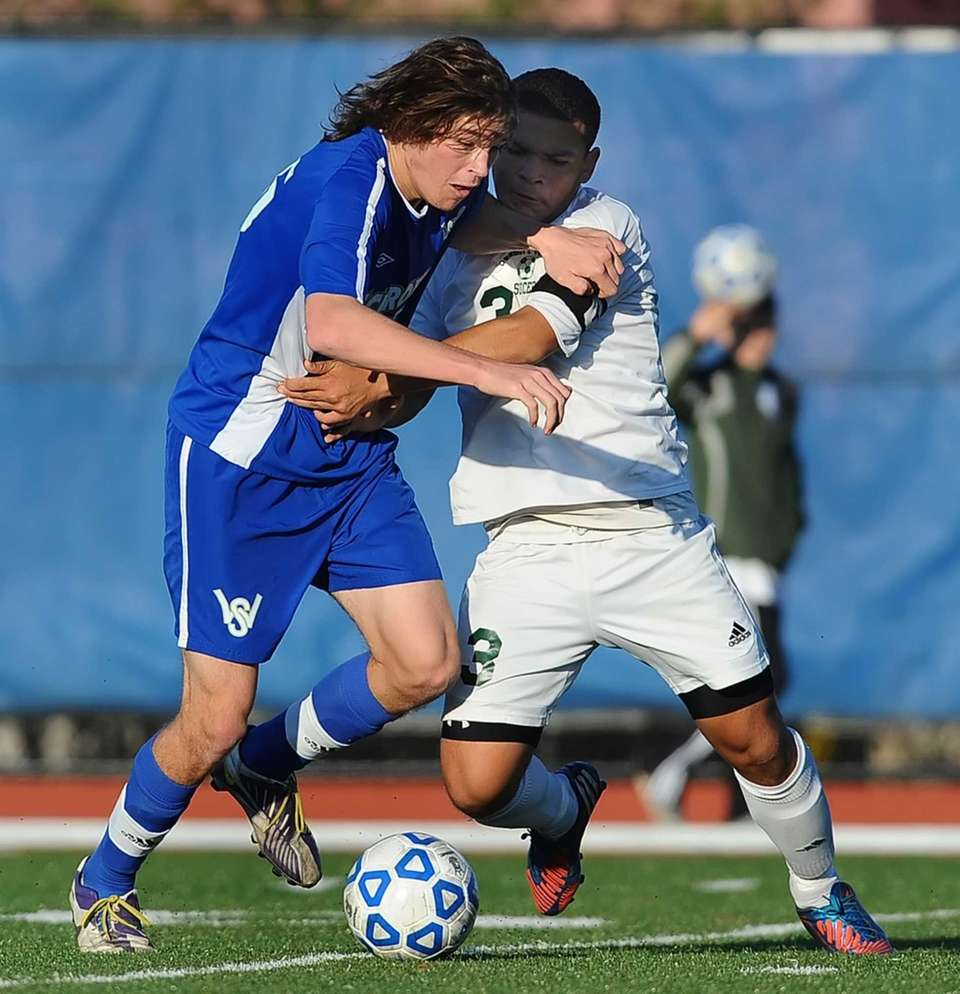 Brentwood's Mario Ruiz, right, challenges for the ball