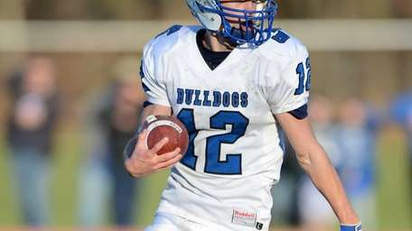 North Babylon's Jake Conner runs to the outside