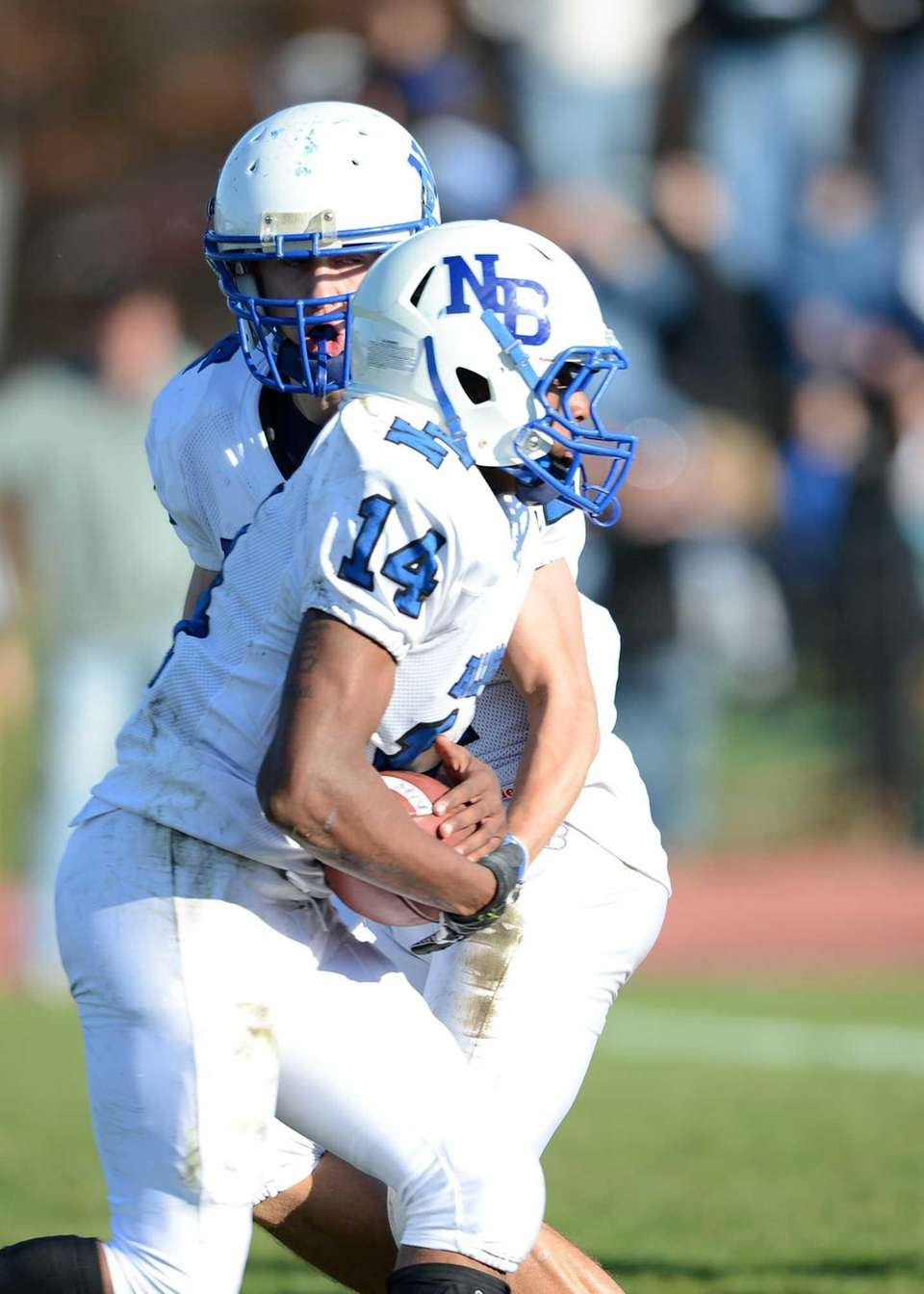 North Babylon's Jake Conner hands off to Melijah