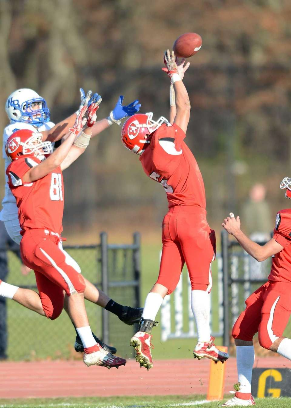 East Islip's Nick Osburn goes up for the