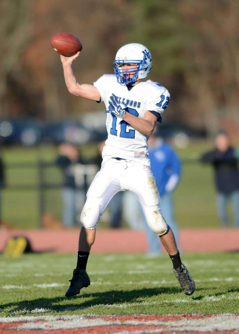 North Babylon's Jake Conner looks to pass downfield