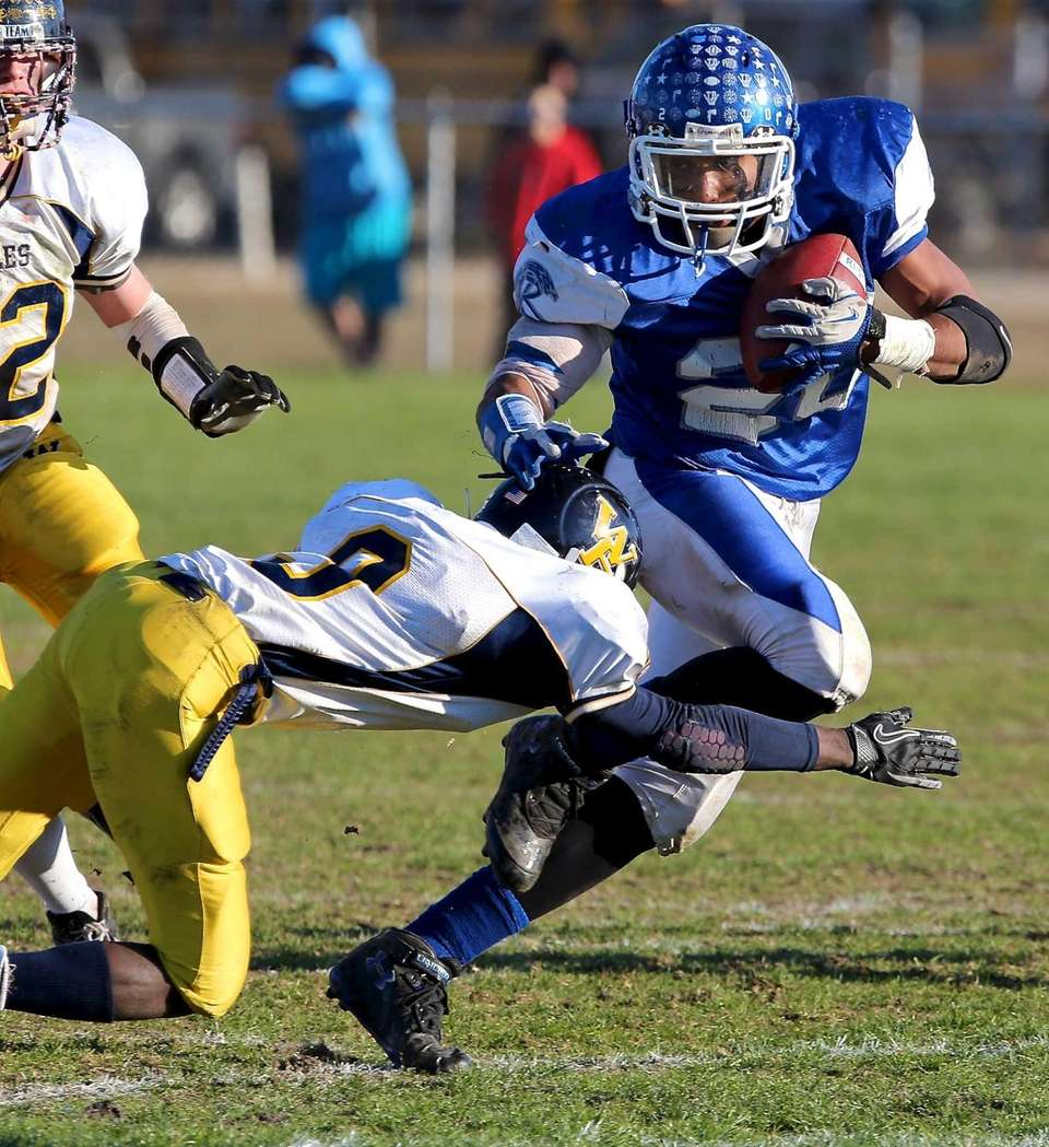 Riverhead running back Jerimiah Cheatom breaks the tackle