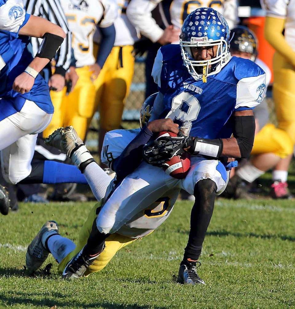 Riverhead receiver Quinn Funn manages to hold onto