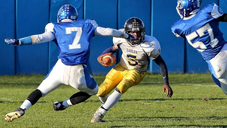 West Babylon quarterback Clifton Melhado looks for running