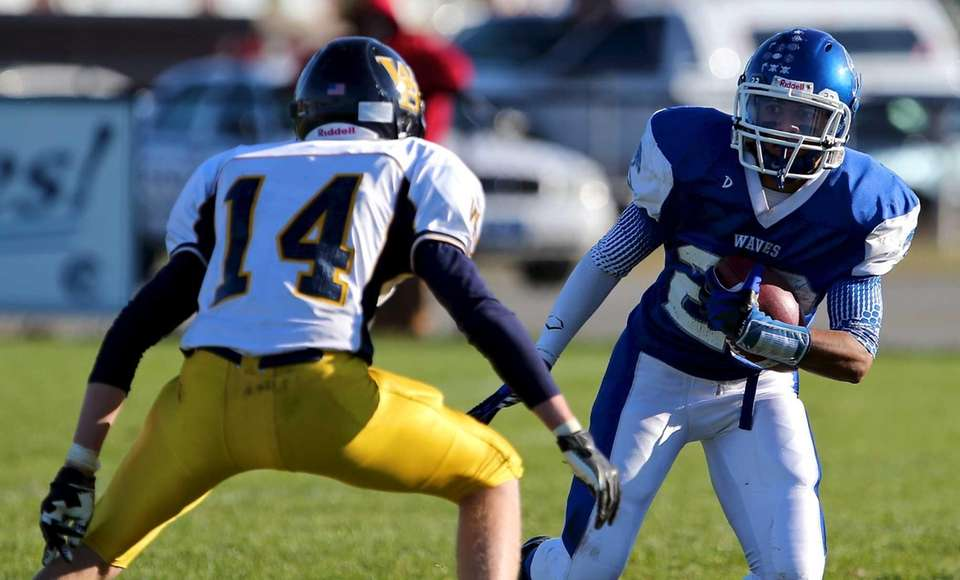 Riverhead receiver Jeffrey Pittman tries to get around
