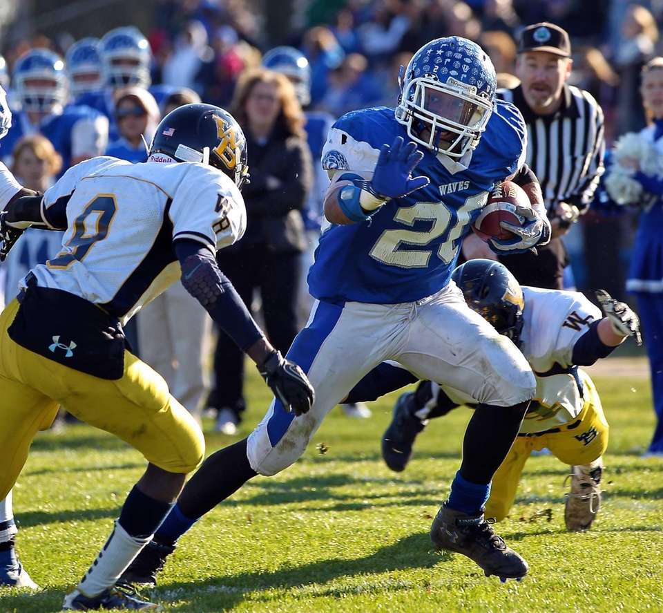 Riverhead running back Jerimiah Cheatom blows past two