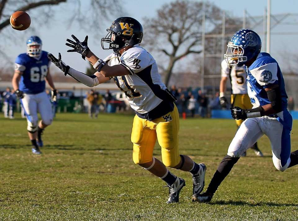 West Babylon receiver Nick Gilly makes the diving