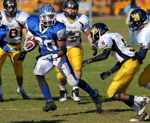 Riverhead running back Jeremiah Cheatom looks for running