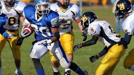 Riverhead running back Jeremiah Cheatom looks for running