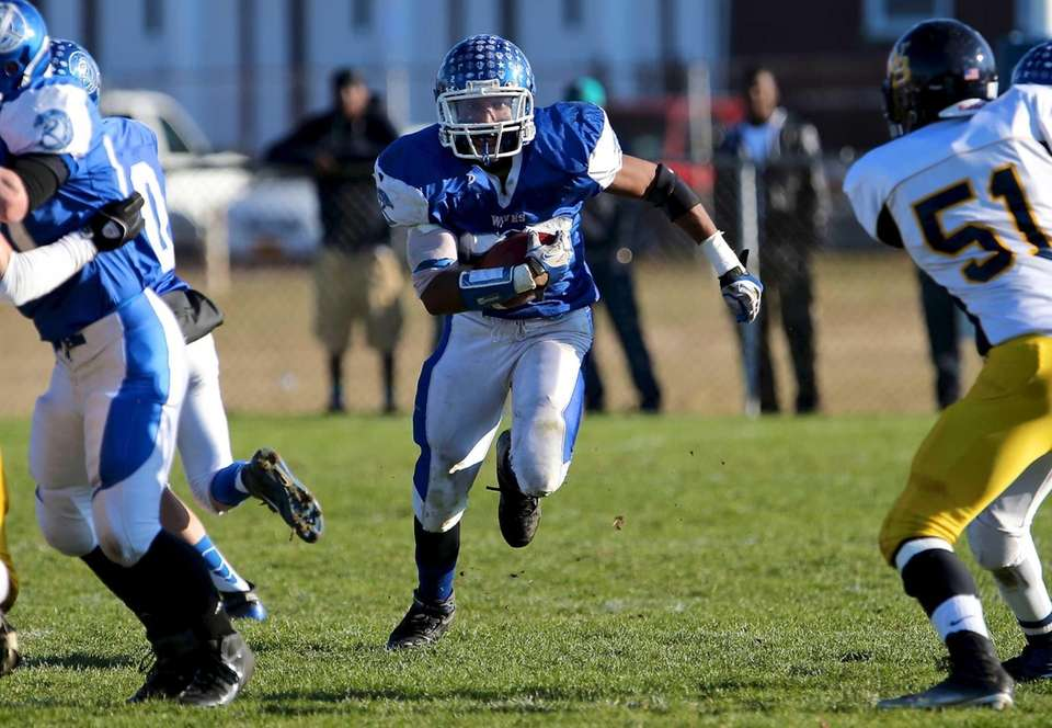 Riverhead running back Jerimiah Cheatom goes straight up