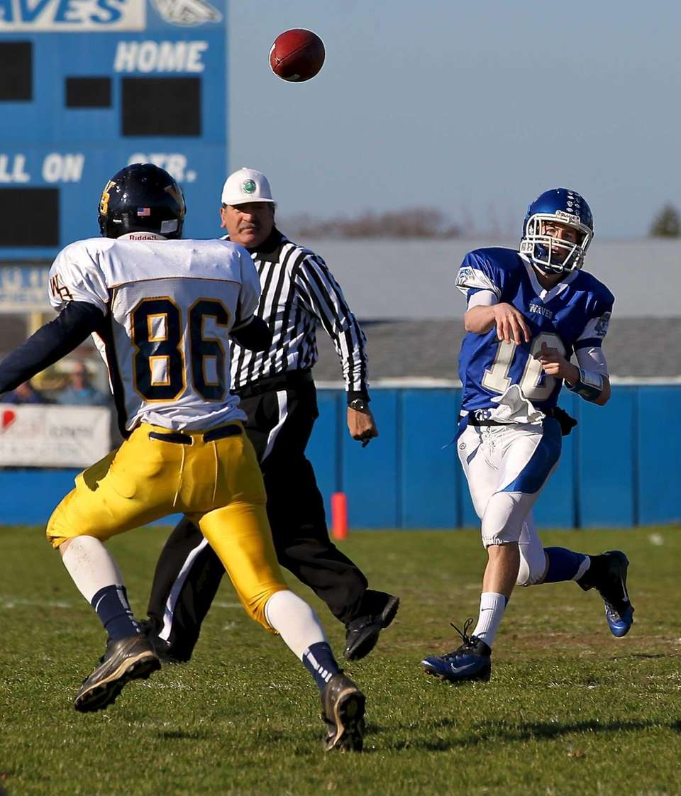 Riverhead quarterback Ryan Bitzer gets the pass off