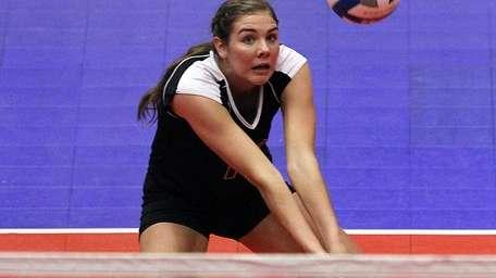 Ward Melville's Emily Astarita gets the dig. (Nov.