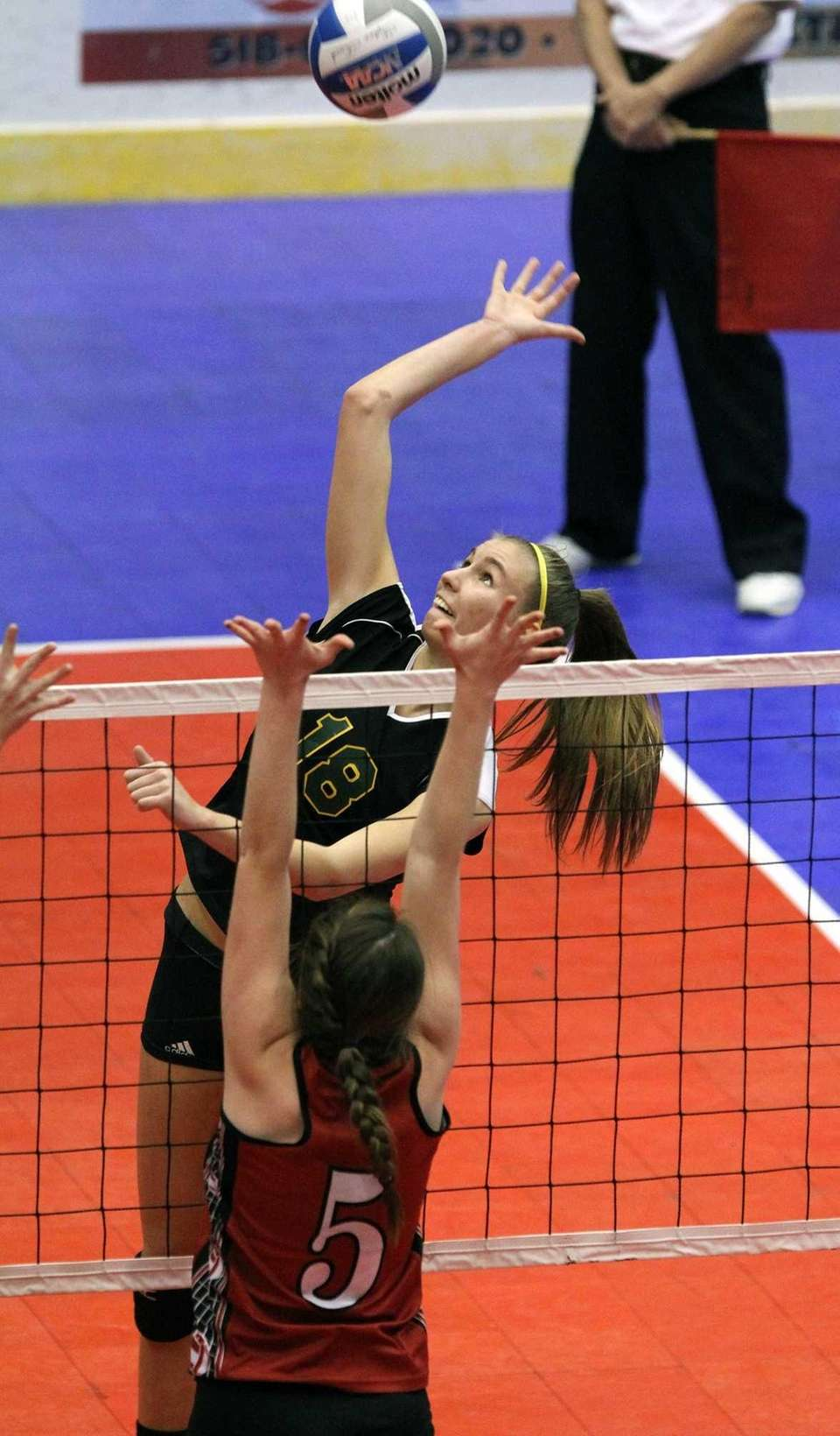 Ward Melville's Kristin Bendy jumps at the net.