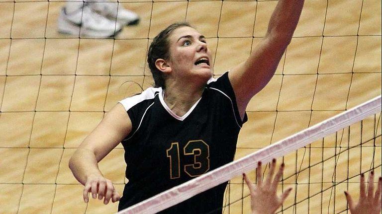 Ward Melville's Emily Astarita tips the ball over