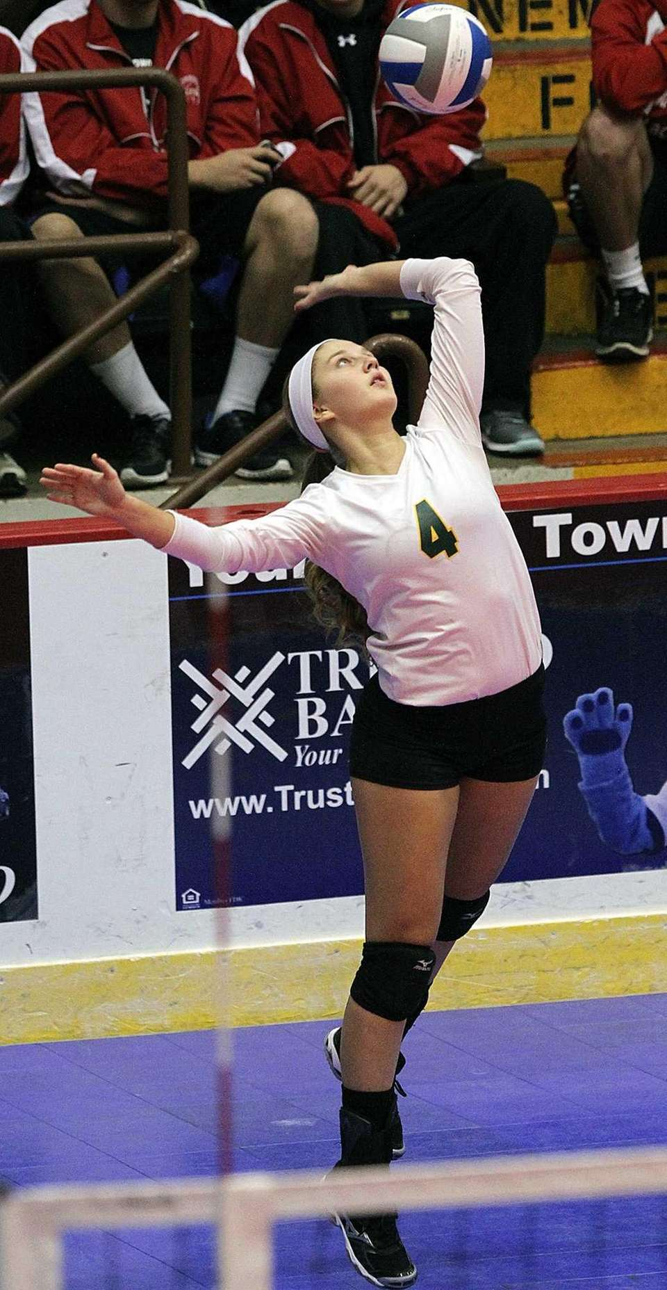 Ward Melville's Carly Lombardo serves the ball. (Nov.