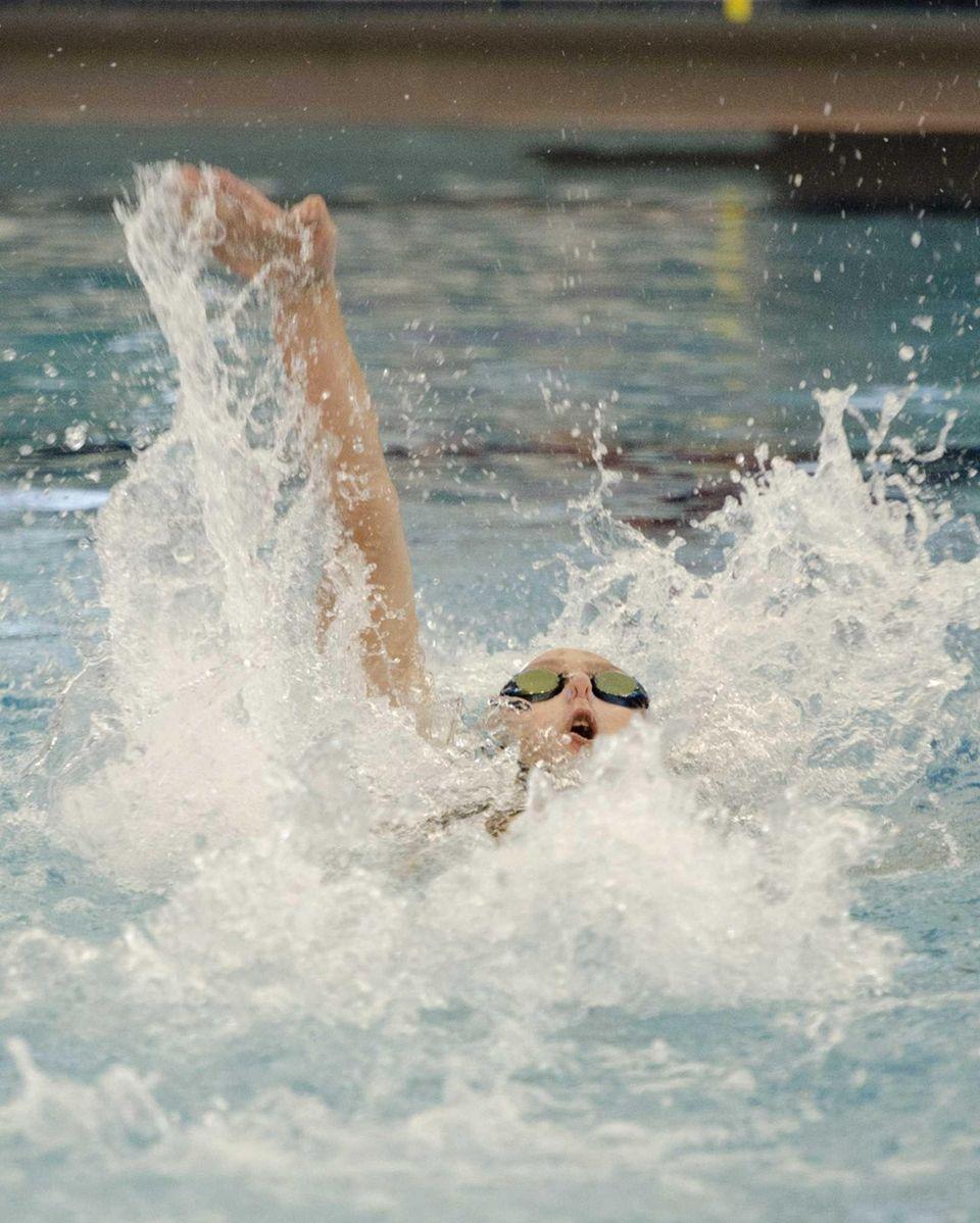 Bellmore-Merrick's Gabbie Toback swims the 100-yard backstroke at