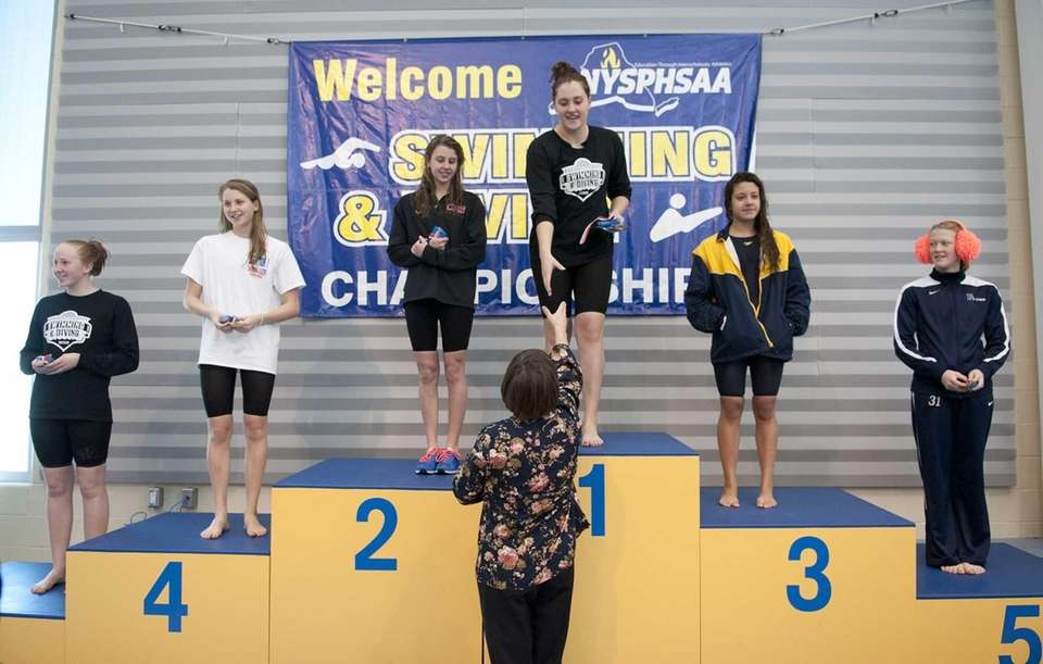 Winners of the 500-yard freestyle stand on the