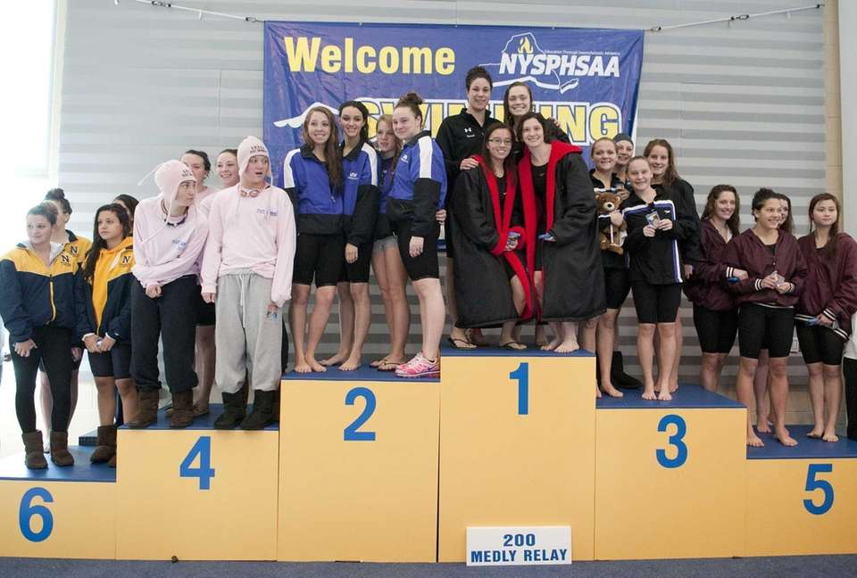 The 200-yard medley relay teams celebrate on the