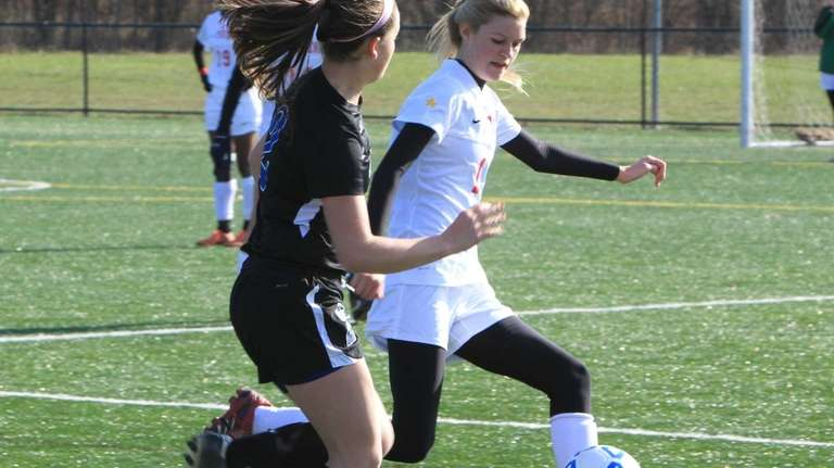 Friends Academy's Jessica Babicz runs with her defender