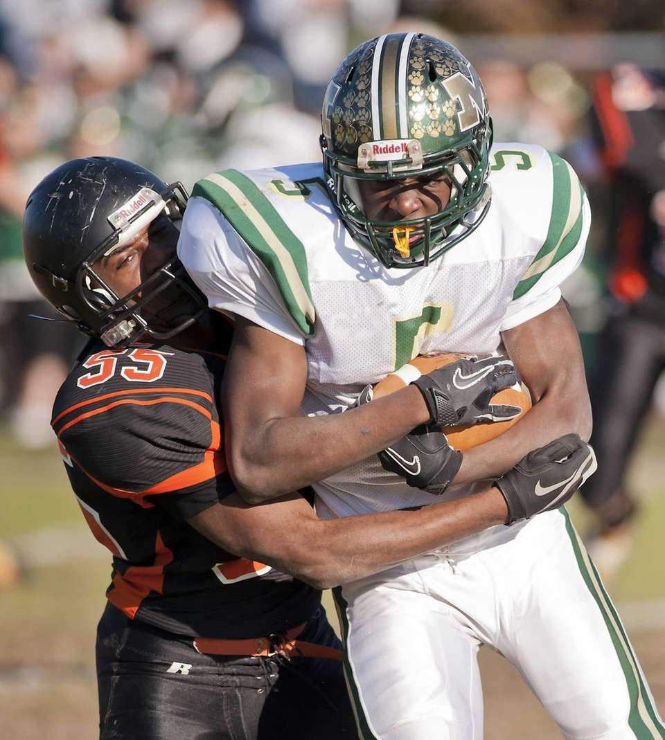 Babylon's Andrew Watson makes a tackle on Mercy's