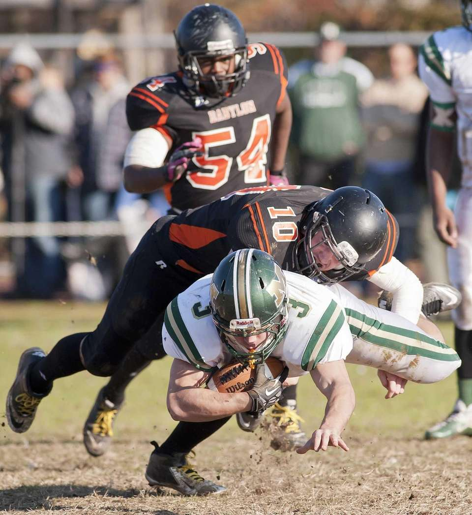 Babylon's Eric Sweitzer makes a tackle on Mercy's