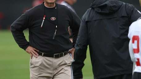 San Francisco coach Jim Harbaugh oversees practice at