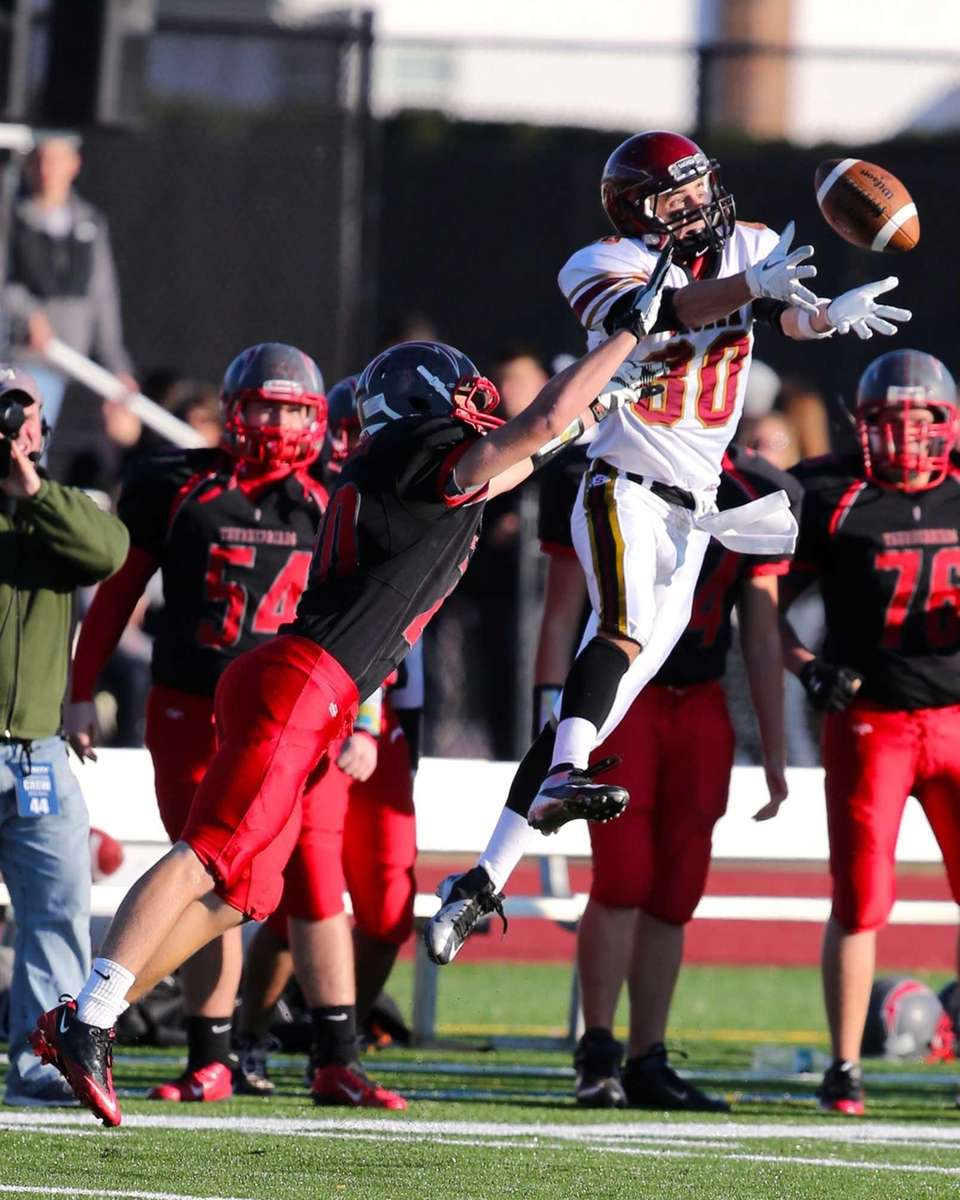Connetquot's Will Kistinger breaks up a pass intended