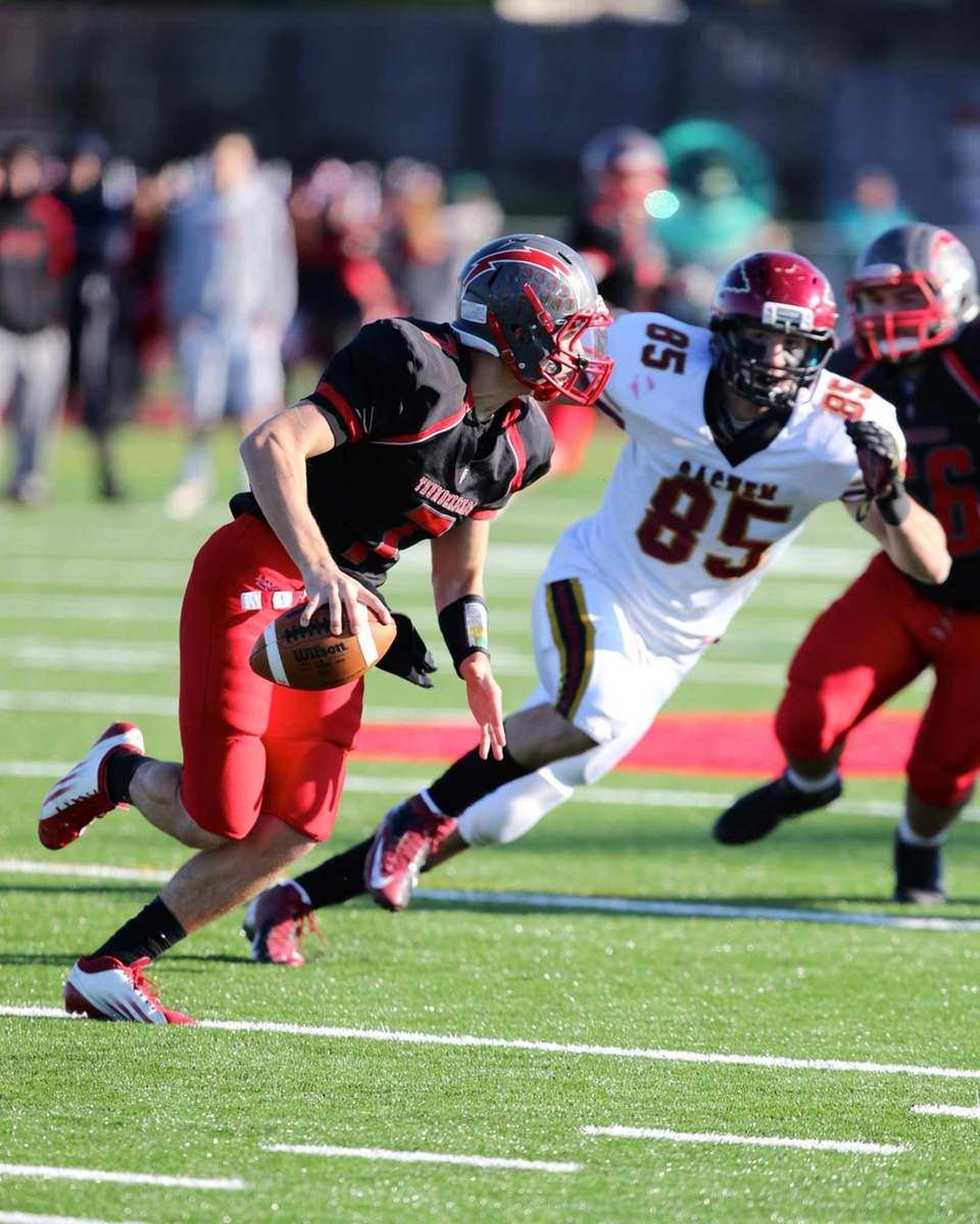 Connetquot's quarterback Brian McKean is forced out of