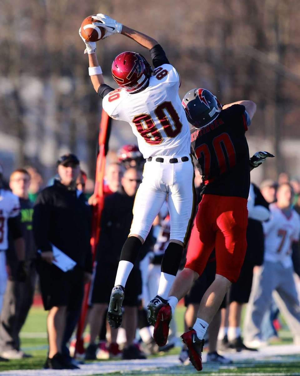 Sachem East's Brian Balsamo catches a pass over