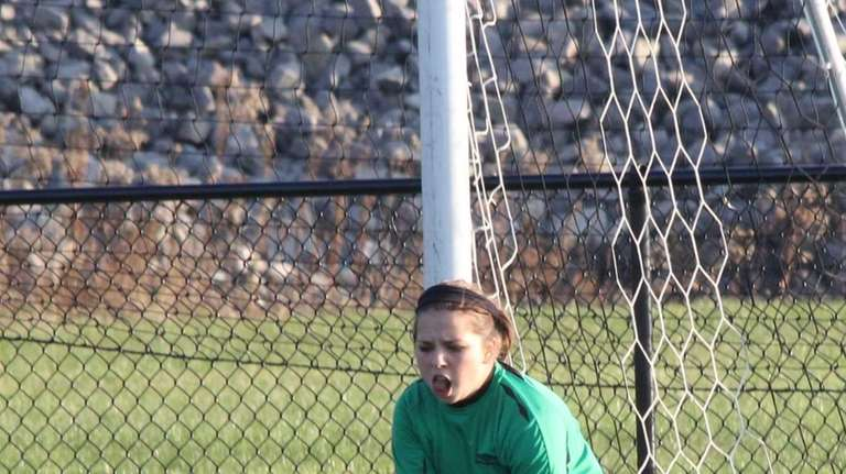 Hannah Steffens of Smithtown Christian goes to block