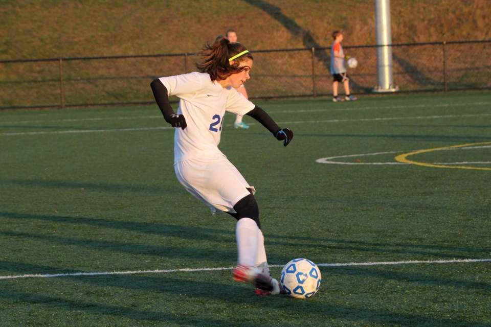 Kristina Reuter of Smithtown Christian goes for a