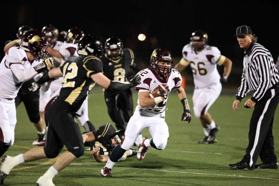 Monsignor Farrell's Brett Bracco runs the ball against