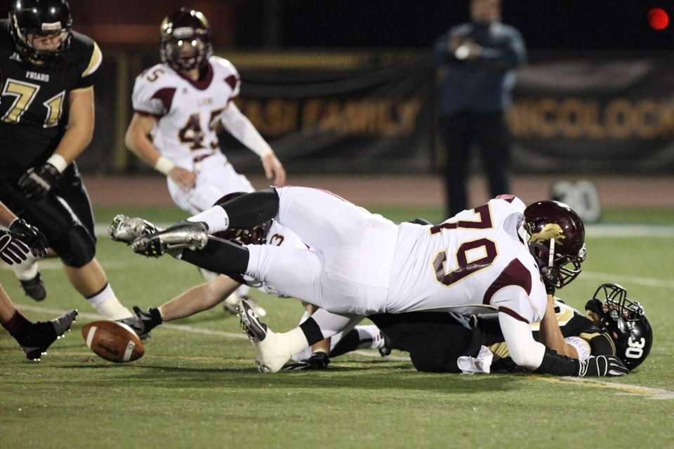 St. Anthony's Brendan Femiano, right, fumbles the ball