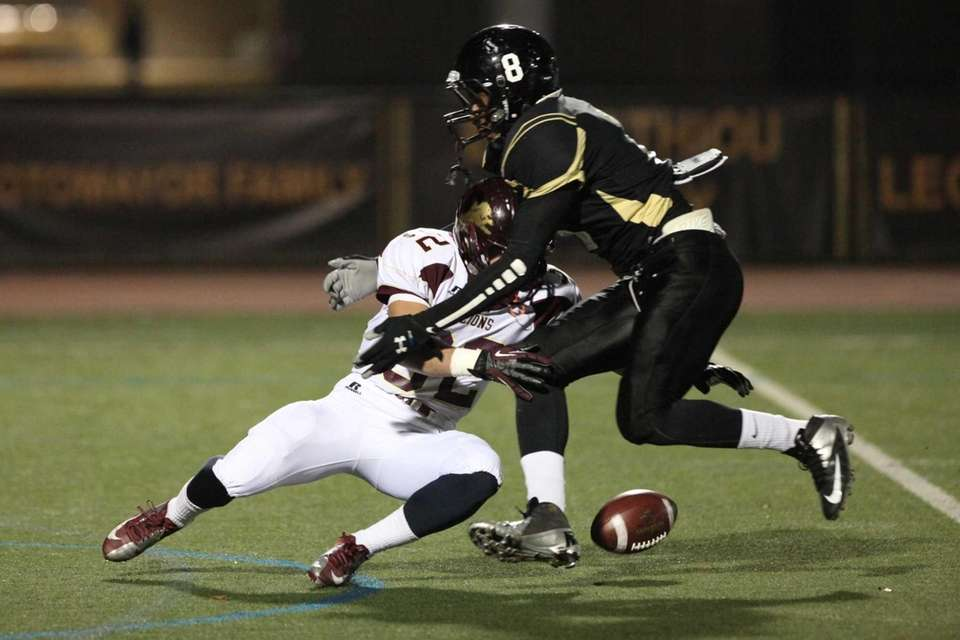 St. Anthony's Joseph Percival, right, draws a fumble