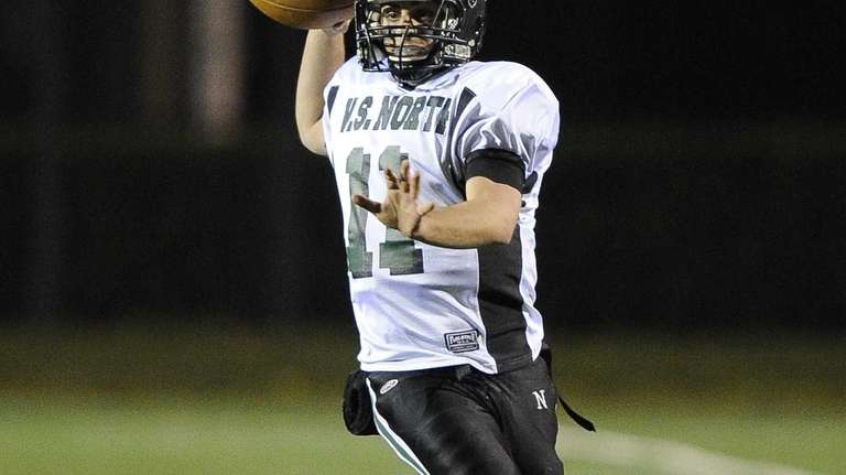 North Valley Stream quarterback Anthony Martelli scrambles and