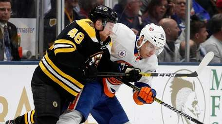 The Islanders' Michael Dal Colle and the Bruins'