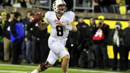 Quarterback Kevin Hogan of the Stanford Cardinal scrambles