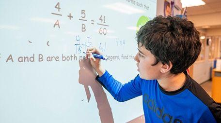 Marc Ake, 12, a seventh-grader and math club