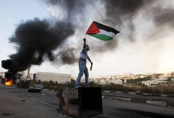 A man waves the Palestinian flag during a