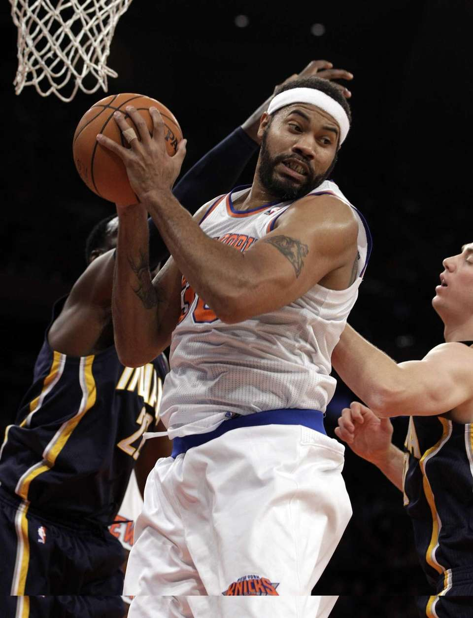 Knicks center Rasheed Wallace pulls down a rebound