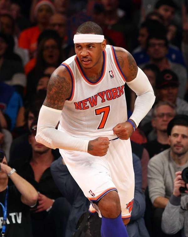 Carmelo Anthony celebrates a basket in the first