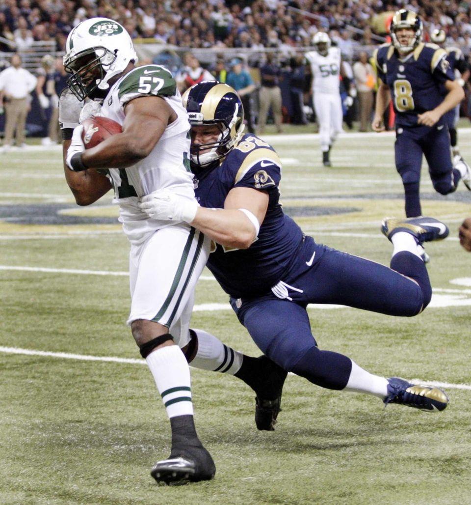 Jets inside linebacker Bart Scott is pulled down
