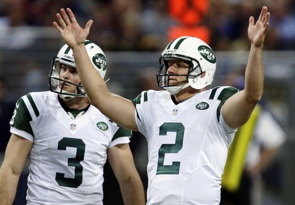 Jets kicker Nick Folk, right, celebrates alongside Robert